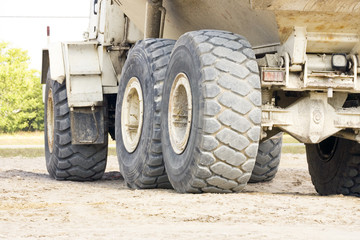 The tires of a heavy duty dump truck