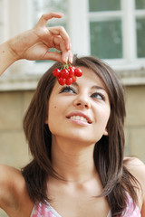 Close up sexy young woman with cherries