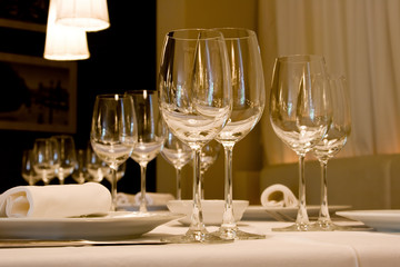 wine glasses set at reataurant table