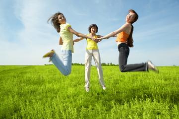 tree girlfriend jump in green field