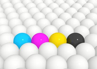 Spheres painted in colors of palette CMYK