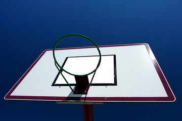 Basketball basket on blue sky background.