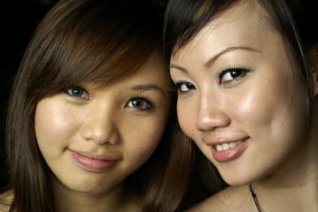 Two happy asian lady friends