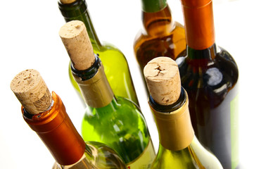 wine bottles with  corks on white