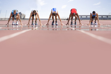 Sprinters on starting blocks, ground view