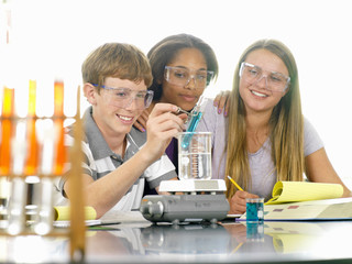 Students with experiment in science class