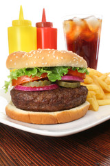Hamburger served with french fries and soda close-up