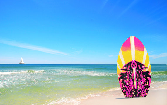 Pink and Yellow Surf board at beach
