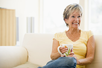 Woman relaxing with coffee smiling