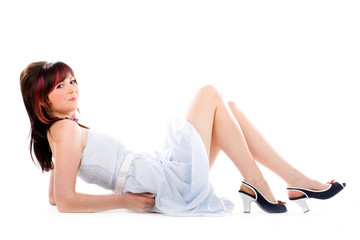 Petite girl leaning on a floor