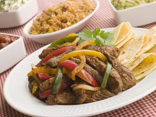 Steak Fajitas with Jambalaya, Guacamole, Salsa and Sour Cream