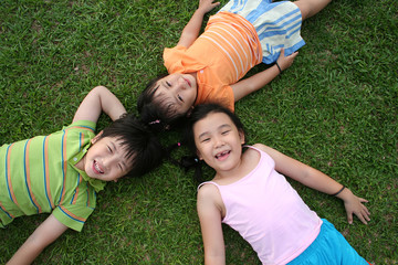 Kids lying on the grass