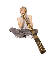 Guy's playing  didgeridoo