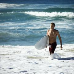 Teen surfer in water.