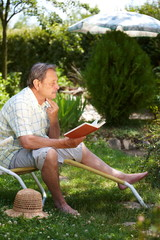 Elderly man reading book