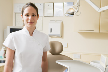 Dental assistant in exam room smiling