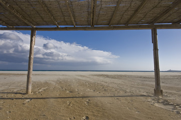 under the beach canopy