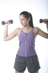 woman exercising and lifting weights isolate
