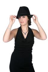 teenage girl in slim black dress and top hat