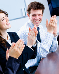 Clapping businesspeople