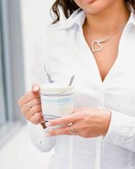 Business woman drinking coffee