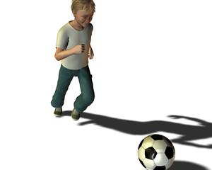 Garçon s'élançant vers un ballon
