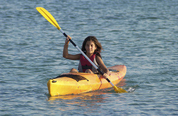 Young girl learning to kayaking