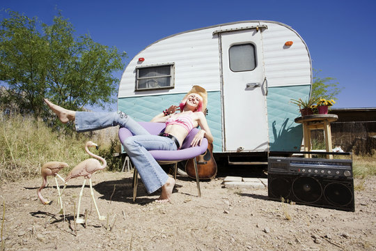 Woman in front of Travel Trailer