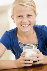 Young girl drinking milk smiling