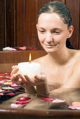 Woman in Tub with a Candle - Vertical