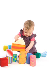 Baby palying with toy blocks