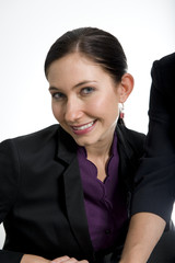 brunette business woman sitting at desk in office