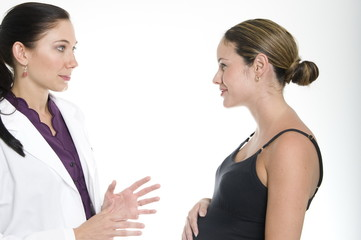 pregnant woman and her doctor