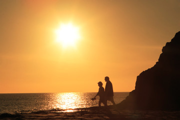 mature couple walking in sunset