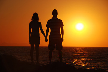 girl and boy watching sunset