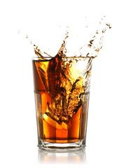 ice cube splashing into glass of cola
