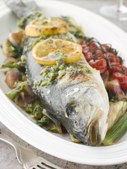 Whole Roasted Sea Bass with Fennel Lemon Cherry Vine Tomatoes an