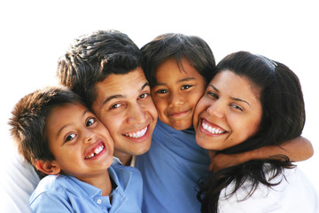 Happy Family Embracing & Laughing Together Outdoors