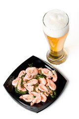 Beer in a glass and a dish with shrimps