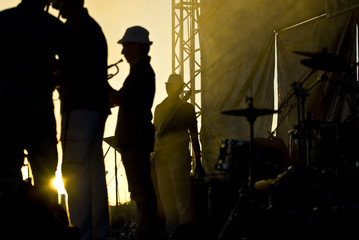 Silhouette of musicians at the stage