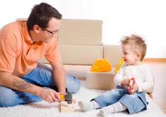 Father and kid playing