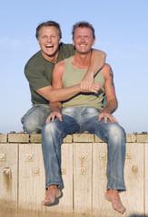A happy gay couple having fun.