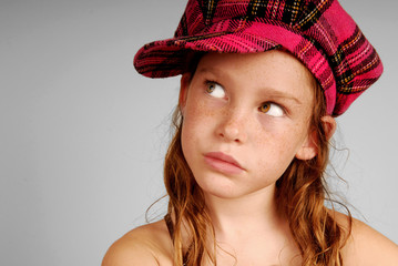 Young girl in plaid cap