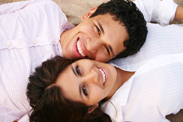 Couple Smiling on the Beach Relaxing