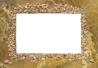 Original photo frame decorated with marine mollusks and stones