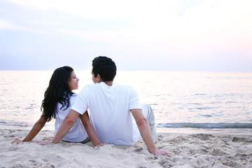 Couple Facing Toward the Water on their Honeymoon