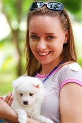 Girl with cute white puppy