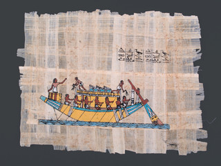 ancient egyptian papyrus painting of nile boat and hieroglyphs