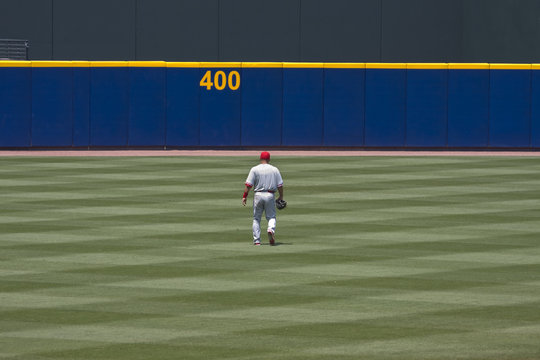 Baseball player walking to outfield