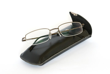 Spectacles and spectacle-case isolated on white.